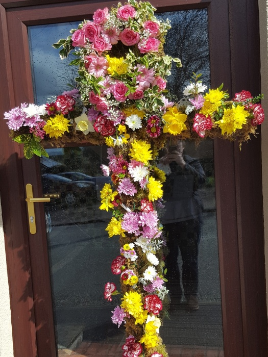 Easter 16 Cross with flowers outside Church