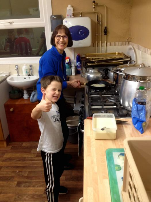 Helen and Lucas making pancakes